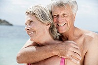Spain, Senior couple embracing on beach