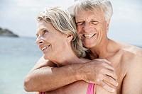 Spain, Senior couple embracing on beach