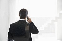 Spain, Businessman talking on mobile phone (thumbnail)