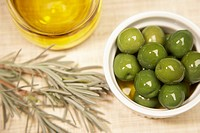 Green olives with olive and rosemary