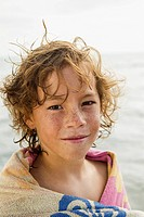 Spain, Portrait of boy at Atlantic Ocean, smiling