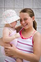 Girl holding baby