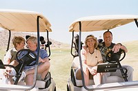 Two Couples in Golf Carts