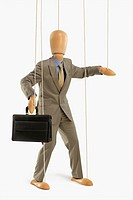 Puppet dressed as a businessman