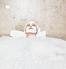 Woman 36y with facial mask in bathtub