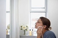 girl cleaning face