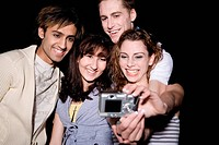 Friends take a photograph of themselves