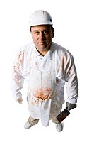 Butcher standing with knife