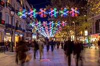 Portal de l'Angel pedestrian street adorned with Christmas lights, Barcelona, Catalonia, Spain