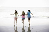 Group of Teen Girls On Beach At Water´s Edge