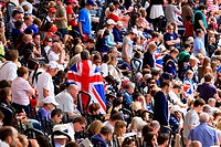 Crowd of British spectators with Union flags in a sports arena, London, England, United Kingdom, Europe