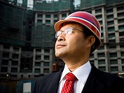 Businessman with construction helmet outdoors