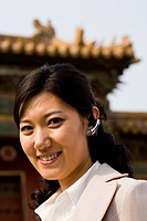 Businesswoman smiling outdoors with headset