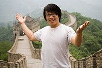 Young man at the Great Wall of China.