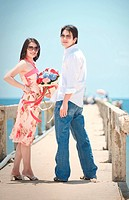 portrait of couples at pier on the beach