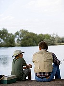 father and son out fishing.