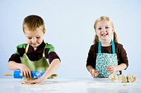 boy and girl kneading dough