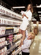 Man Lifting Woman in Store