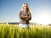 businesswoman standing in a field