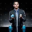 businessman playing the cup game