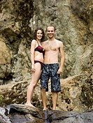 couple standing above a rock waterslide