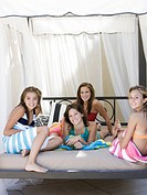 teenagers in a poolside cabana