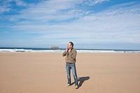 Man walking along the beach