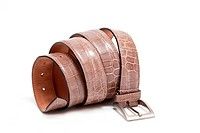 A coiled brown crocodile leather belt