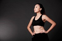 Confident Asian Woman in Workout Outfit