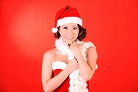 Chinese Woman Wearing Christmas Hat and Outfit
