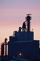 Silhouette of a grain storage facility