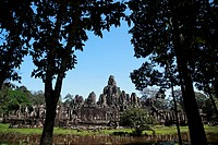 View of Bayon Temple through trees, Angkor Wat, Cambodia