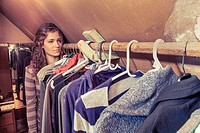 Teen girl in her mother´s clothes closet