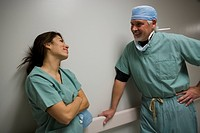 Close_up of a male surgeon and female surgeon talking