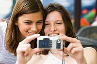 Two teenage girls taking a picture together