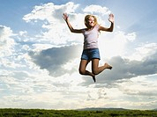Low angle view of a young woman jumping