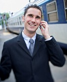 Close_up of a businessman talking on a cell phone
