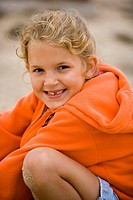 Girl with sand on knee smiling