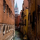 Gondola on canal with historic buildings Venice Italy