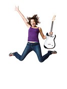 Girl with electric guitar jumping and smiling with arm up
