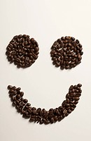 A smiley face arranged in coffee beans