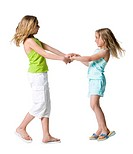 Girls dancing and holding hands