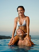 Couple relaxing in infinity pool