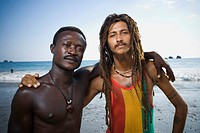 Two black male friends on beach