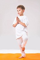 Children´s yoga. The little boy does exercise.