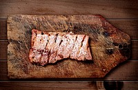 Pork ribs on wooden table
