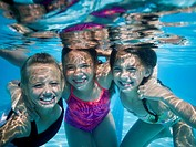 Girls swimming underwater in pool
