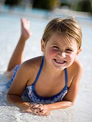 Young girl in wading pool