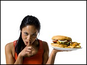 Woman eating a supersized hamburger