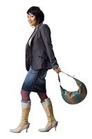 Woman with knee high boots and handbag